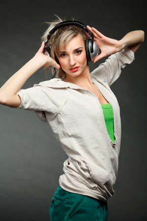 Young girl listening to music by headphones photo