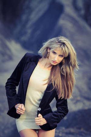 Beauty blonde posing over dark sky background Stock Photo