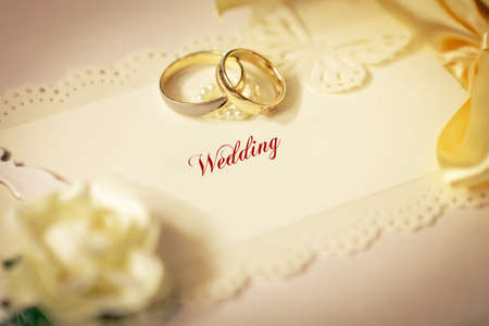 Wedding rings and wedding invitation with bow Stock Photo - 11341718