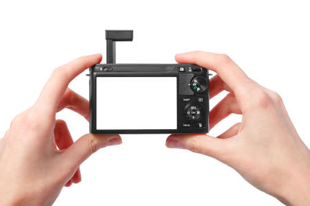 Closeup image of two hands black compact digital photo camera with empty display for your picture or text