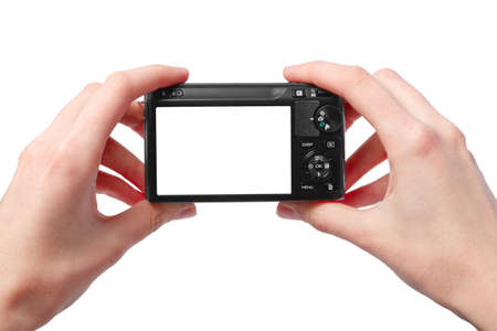 filming: Closeup image of two hands black compact digital photo camera with empty display for your picture or text