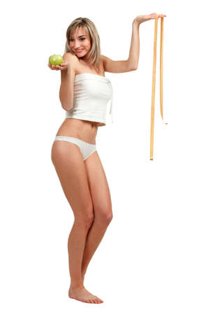 sexy food: Beautiful woman measuring her waist, white background