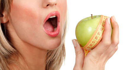 woman holding an apple on a white background