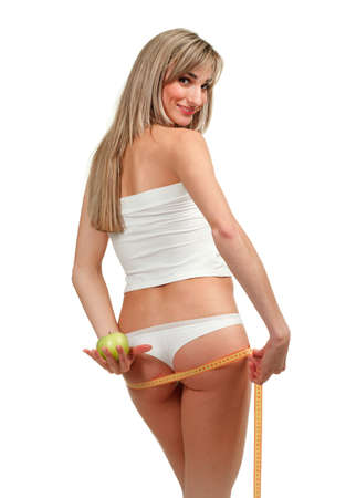 Beautiful woman measuring her waist, white background
