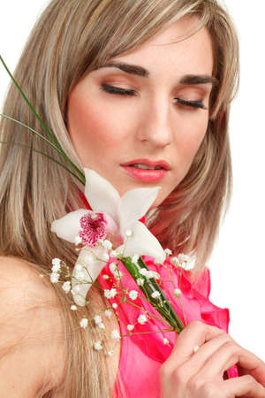 Beautiful blond girl with orchid flower isolated on white background  photo
