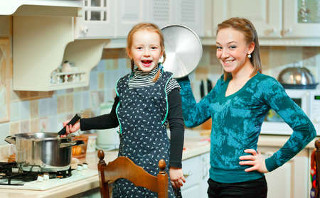 Happy woman and child preparing food together