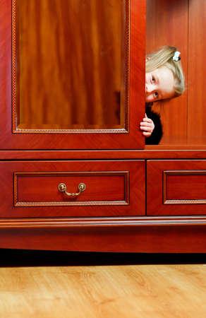 mischief: Child hiding in wardrobe