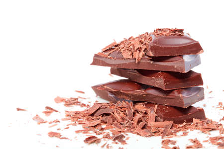 chocolate pieces on white background