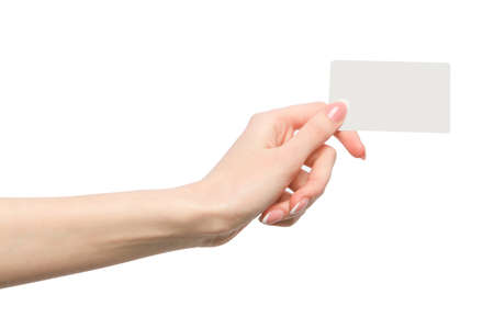 business card in hand: Female hand holding a blank business card
