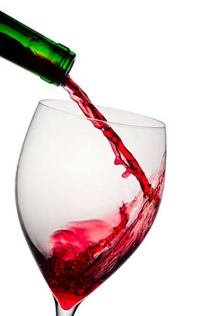 Pouring red wine in glass goblet isolated on white Stock Photo - 12751197