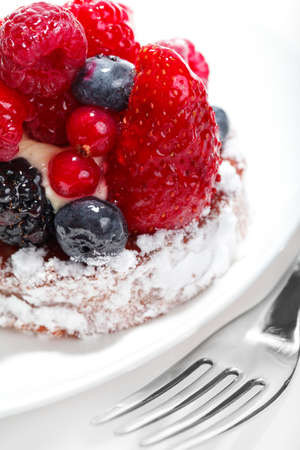 Cake with Berries over white photo