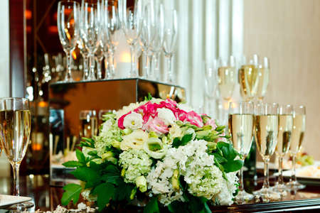 Glasses of champagne, flowers Stock Photo