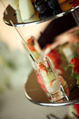 vertica: Glasses with seafood snacks - banquet dish