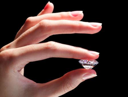 Female hand holding diamond Stock Photo - 15813524