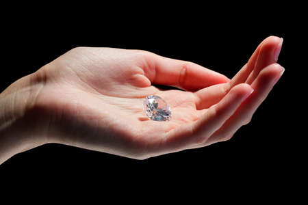Female hand holding diamond Stock Photo