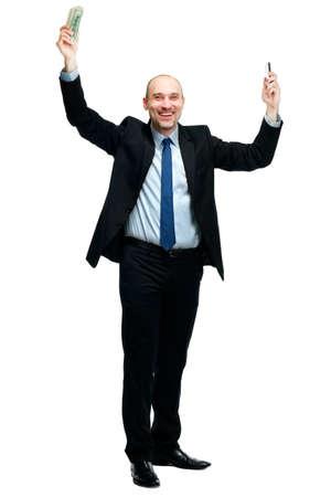 unexpectedness: Hombre feliz celebraci�n de dinero y el tel�fono, aislado en el fondo blanco Foto de archivo