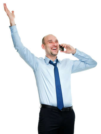 Happy businessman winning while talking on the phone Stock Photo