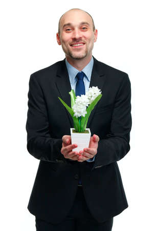 picture of handsome man with flower pot in hand Stock Photo