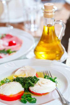caprese salad: slices of mozzarella and tomato