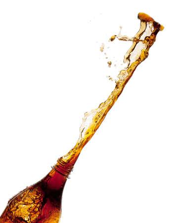 Cola splash from a bottle