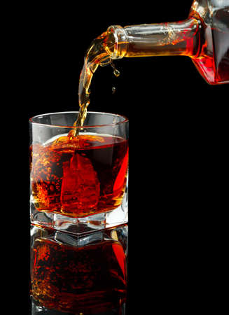 Whiskey glass and bottle on a black Stock Photo - 20244233