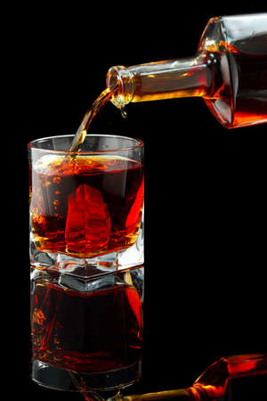 drunks: Whiskey glass and bottle on a black