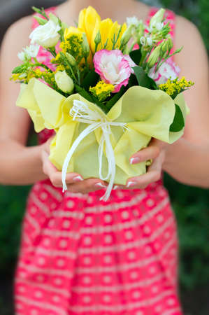 Florist hands showing bouquet flowers shop market photo