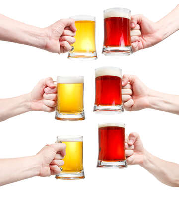 Set, closeup of a male hand holding up a glass of beer over a white background Stock Photo - 20903337