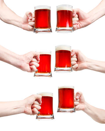 Set, closeup of a male hand holding up a glass of beer over a white background Stock Photo - 20903339