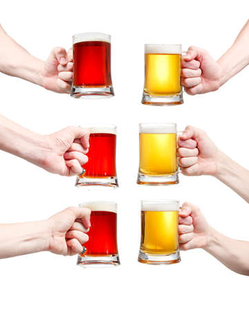 Set, closeup of a male hand holding up a glass of beer over a white background Stock Photo - 20903340