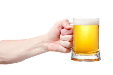 Closeup of a male hand holding up a glass of beer over a white background Stock Photo - 20903356