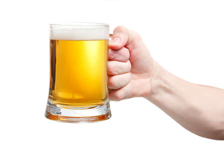 Closeup of a male hand holding up a glass of beer over a white background