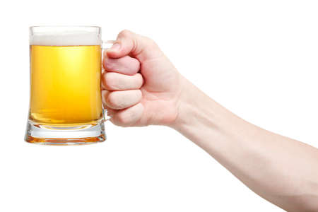Closeup of a male hand holding up a glass of beer over a white background Stock Photo - 20903358