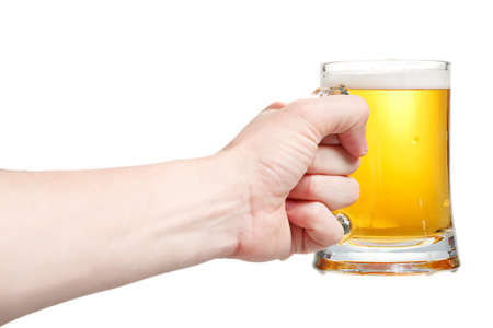 Closeup of a male hand holding up a glass of beer over a white background Stock Photo - 20903359