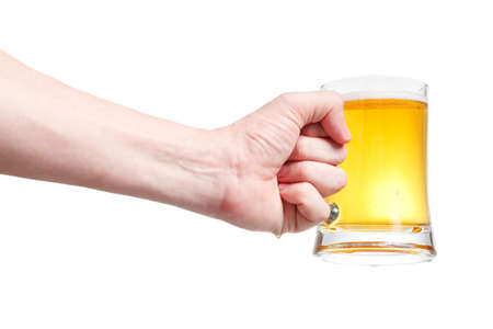Closeup of a male hand holding up a glass of beer over a white background Stock Photo - 20903360