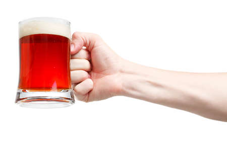 Closeup of a male hand holding up a glass of beer over a white background Stock Photo - 20903361
