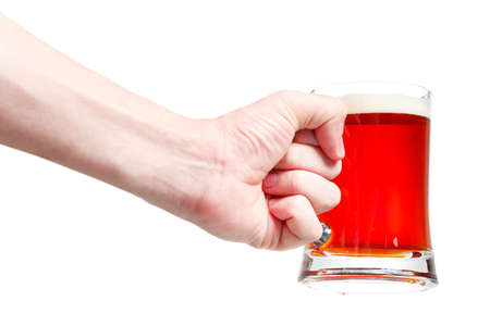 Closeup of a male hand holding up a glass of beer over a white background Stock Photo - 20903364