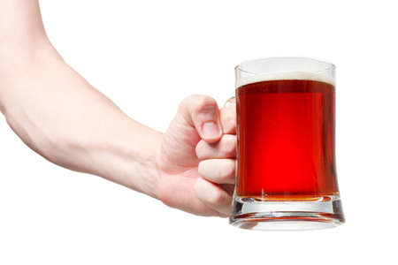 Closeup of a male hand holding up a glass of beer over a white background Stock Photo - 20903365