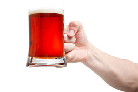 Closeup of a male hand holding up a glass of beer over a white background Stock Photo - 20903366