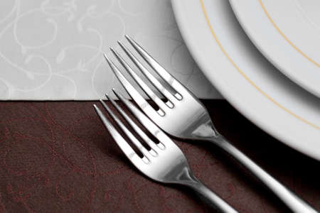 stereotypically: Elegant table setting with fork, knife and napkin