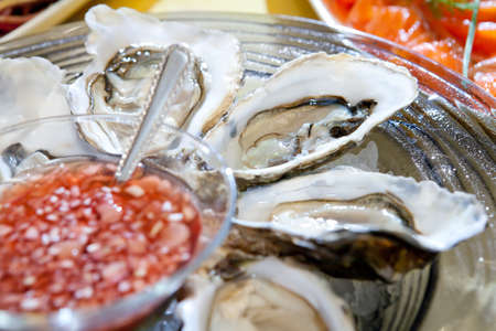 fresh oysters on the ice plate Stock Photo