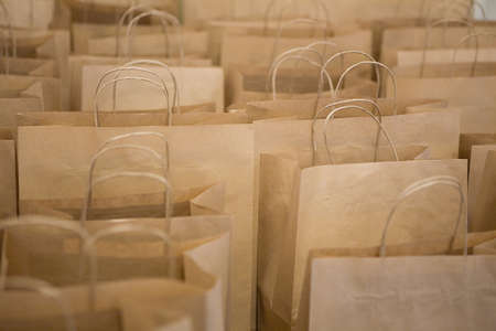 Brown paper bags in rows Stock Photo
