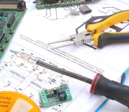 electrics: Electronic circuit and tools, real workplace of electronic engineer Stock Photo