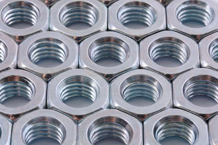 aligned: Close view of aligned nuts
