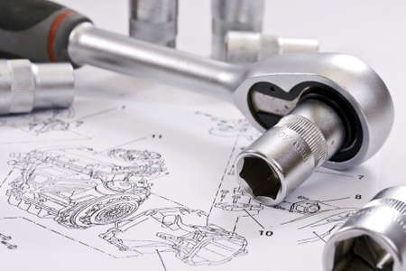 ratchet spanner and sockets on technical draw background photo