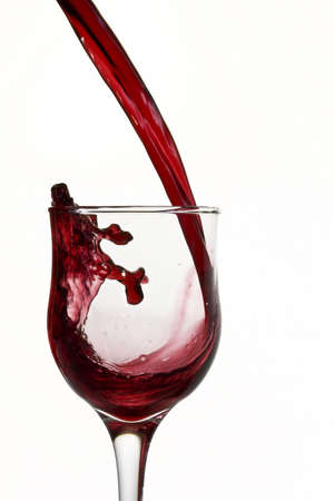 inebriated: Red wine poured into glass Stock Photo