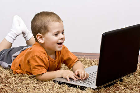 Adorable Boy With Working On Laptop Stock Photo - 5565343