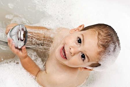 take a bath: Boy playing with shower