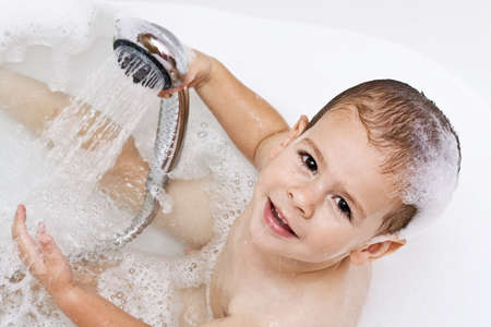 Boy playing with shower