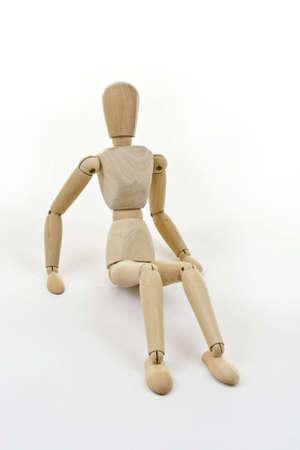 immobile: Detalle de una figura de madera de sesi�n aislada sobre fondo blanco